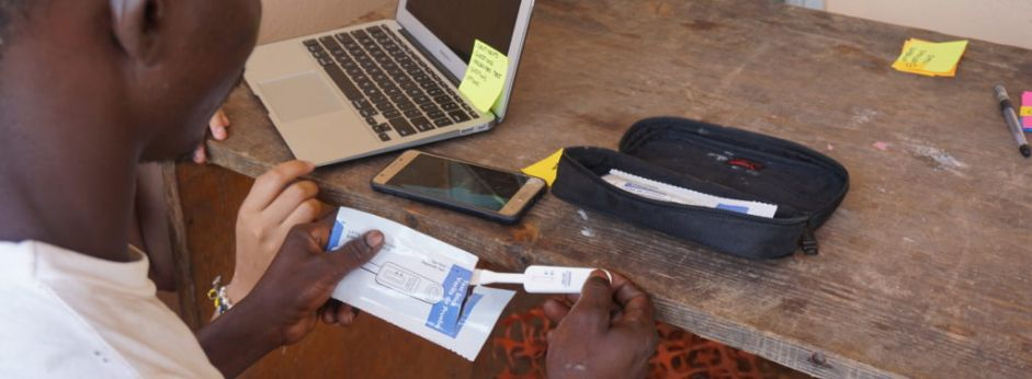 A person carries out an HIV self test