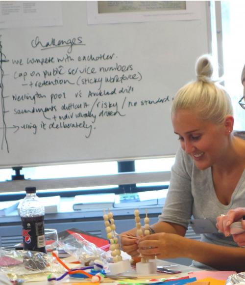 Members of the design team work on their prototype
